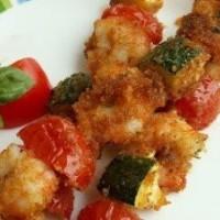 Spiedini di mozzarella fritta con pomodorini